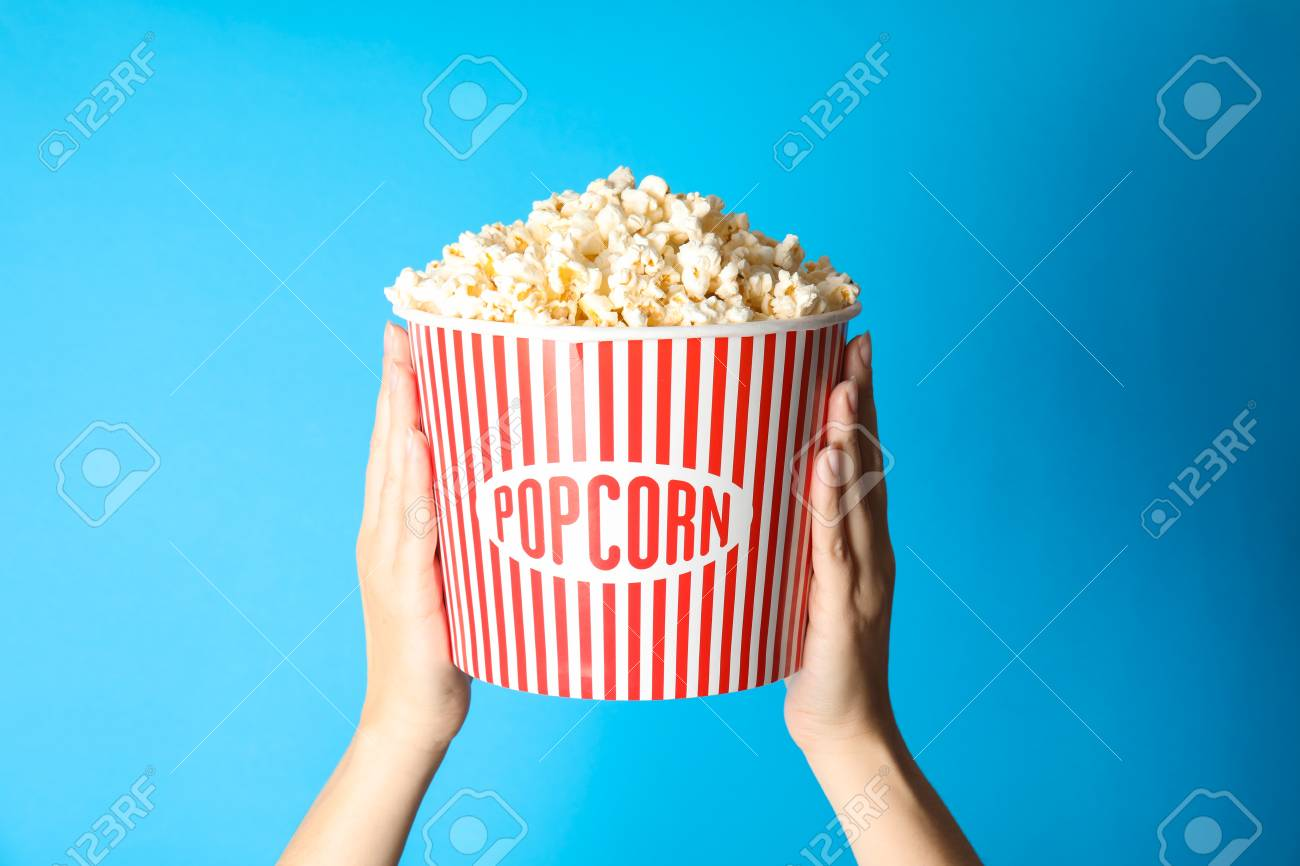 Woman Holding A Popcorn Bucket On Blue Background Cinema Snack Stock Photo Picture And Royalty Free Image Image 116300973
