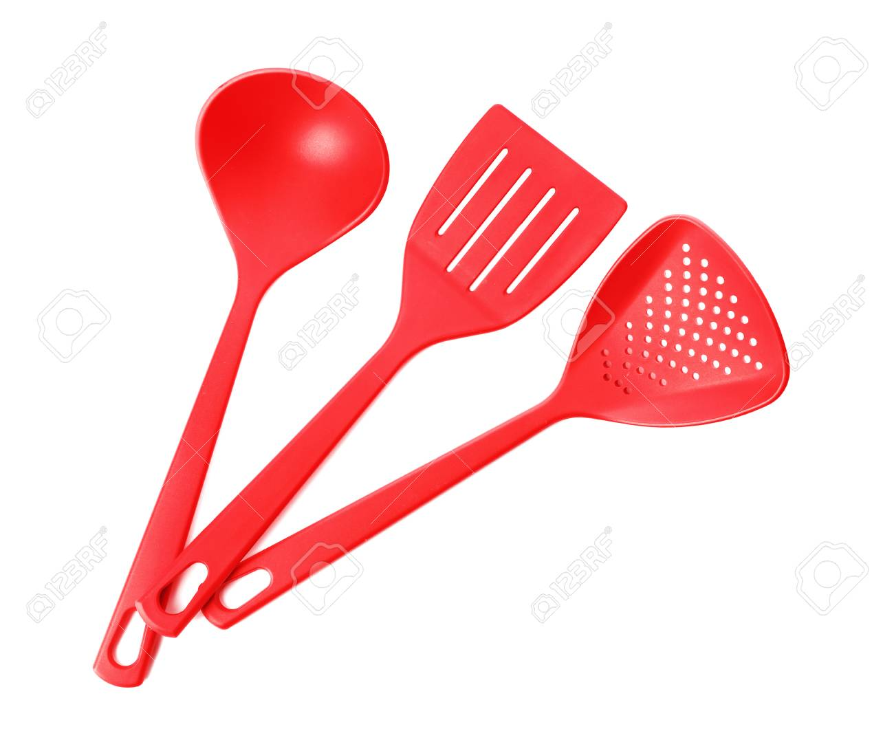 Different colorful kitchen utensils on white background