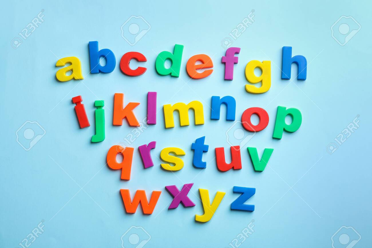Plastic magnetic letters on color background, top view. Alphabetical order - 118227119
