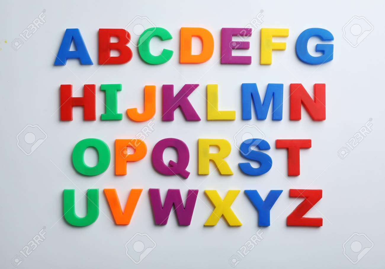 Plastic magnetic letters isolated on white, top view. Alphabetical order - 118223444