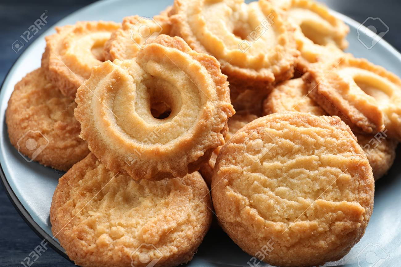 Plate with Danish butter cookies on table, closeup - 118572288