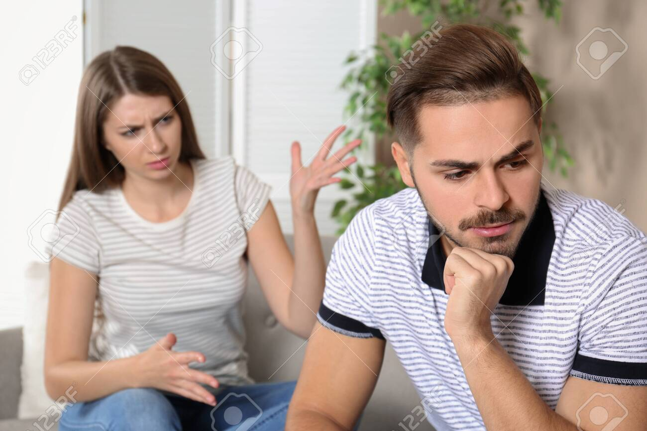Young couple arguing in living room  Relationship problems