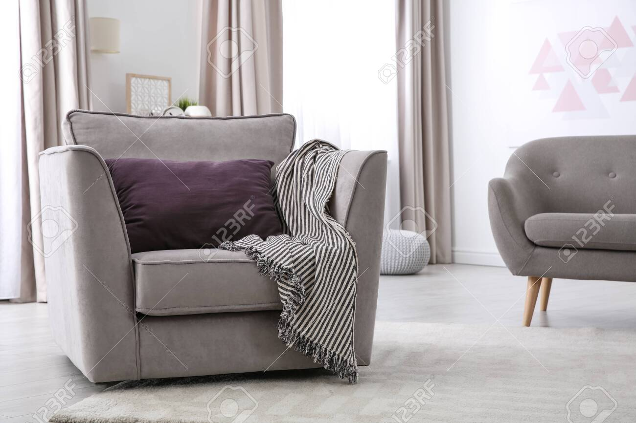 photo fortable armchair with soft cushion in modern living room interior space for text