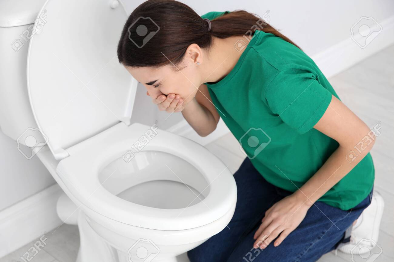 Excellent Young Woman Suffering From Nausea Over Toilet Bowl Indoors Spiritservingveterans Wood Chair Design Ideas Spiritservingveteransorg