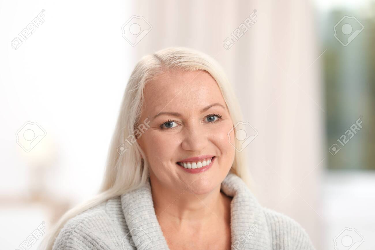 Portrait of beautiful older woman against blurred background - 121157574