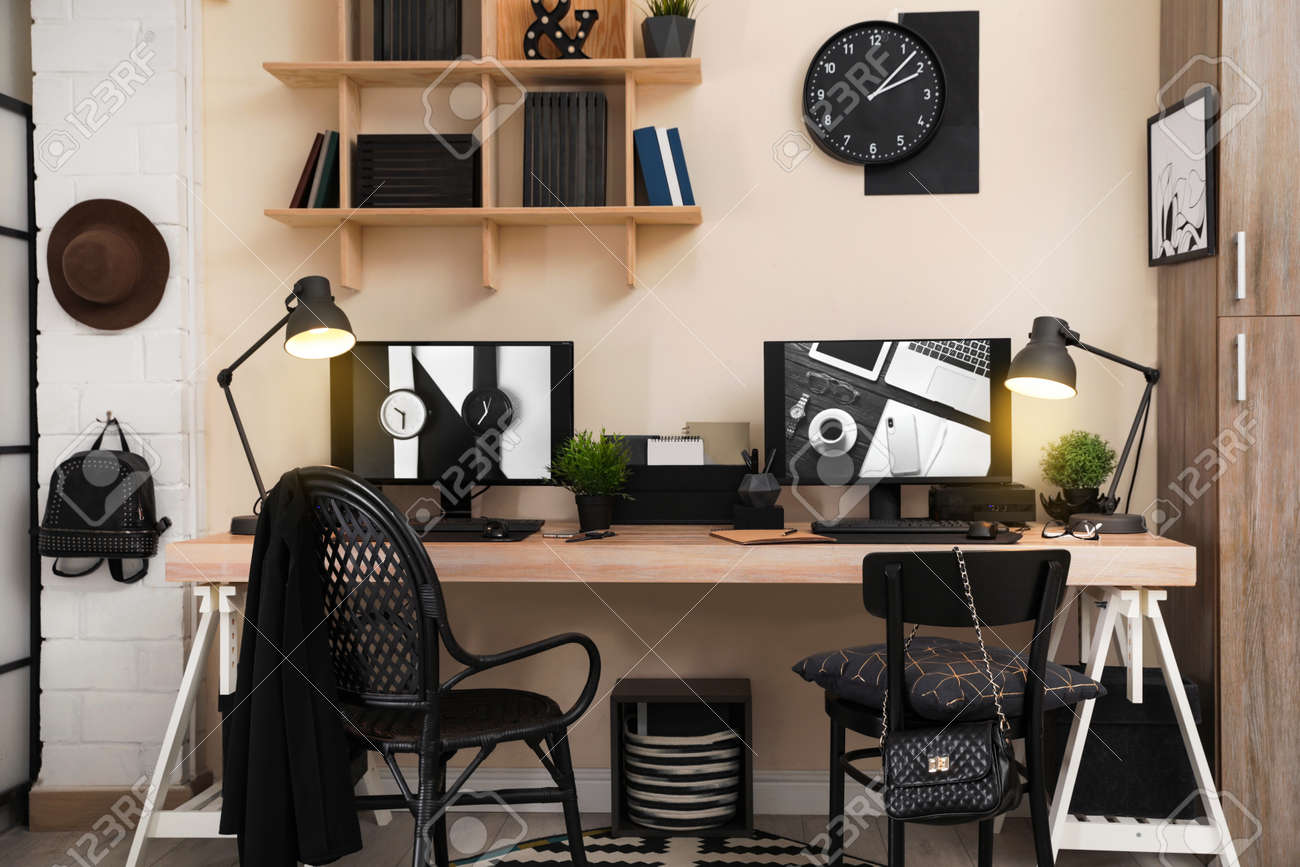 Stylish workplace interior with computers on table - 120964094