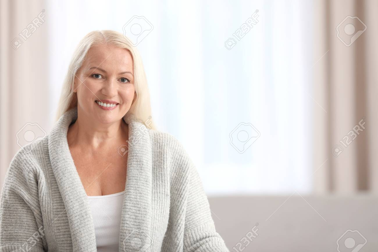 Portrait of beautiful older woman against blurred background with space for text - 121214952