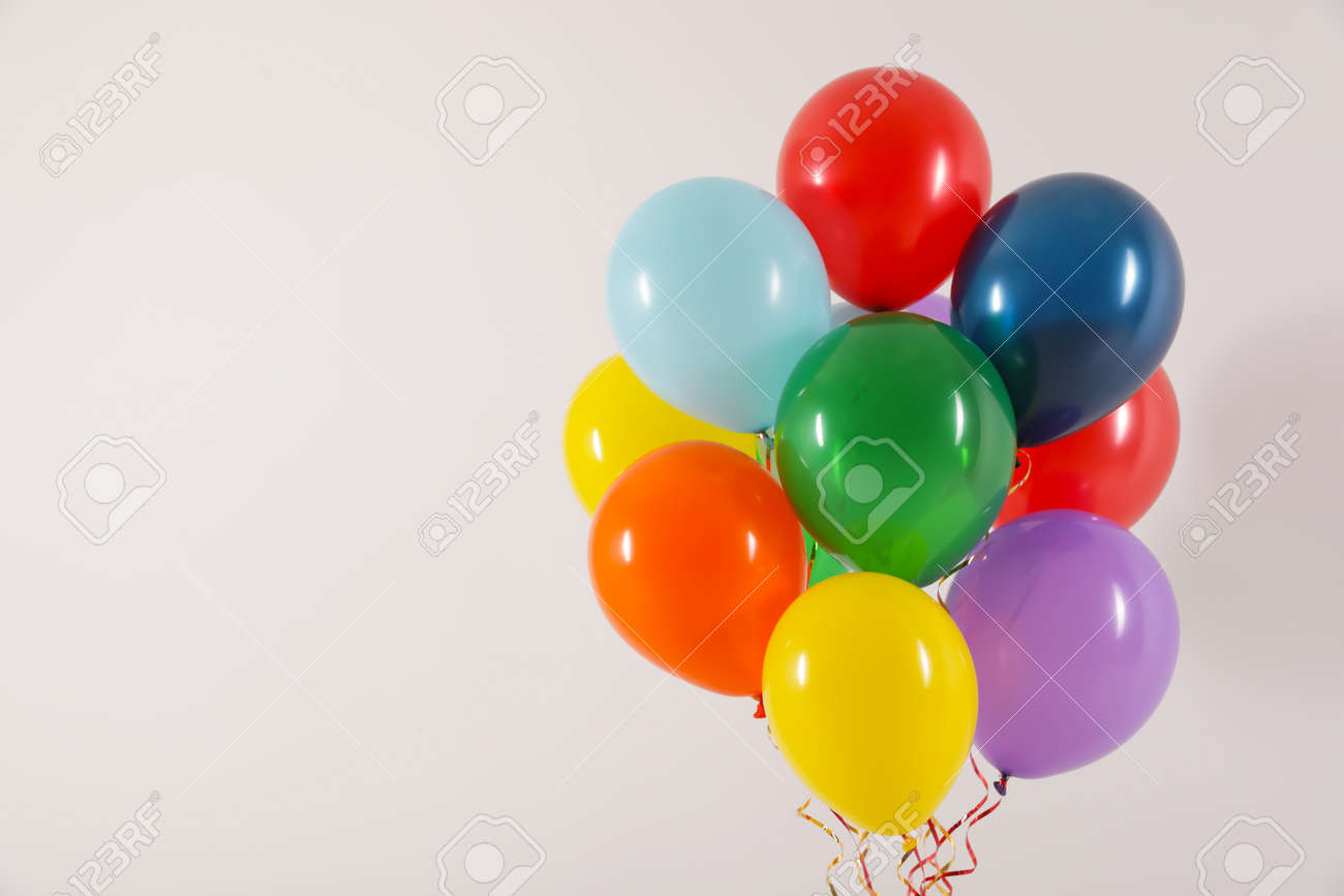 Bunch of bright balloons on light background, space for text. Celebration time - 122066317