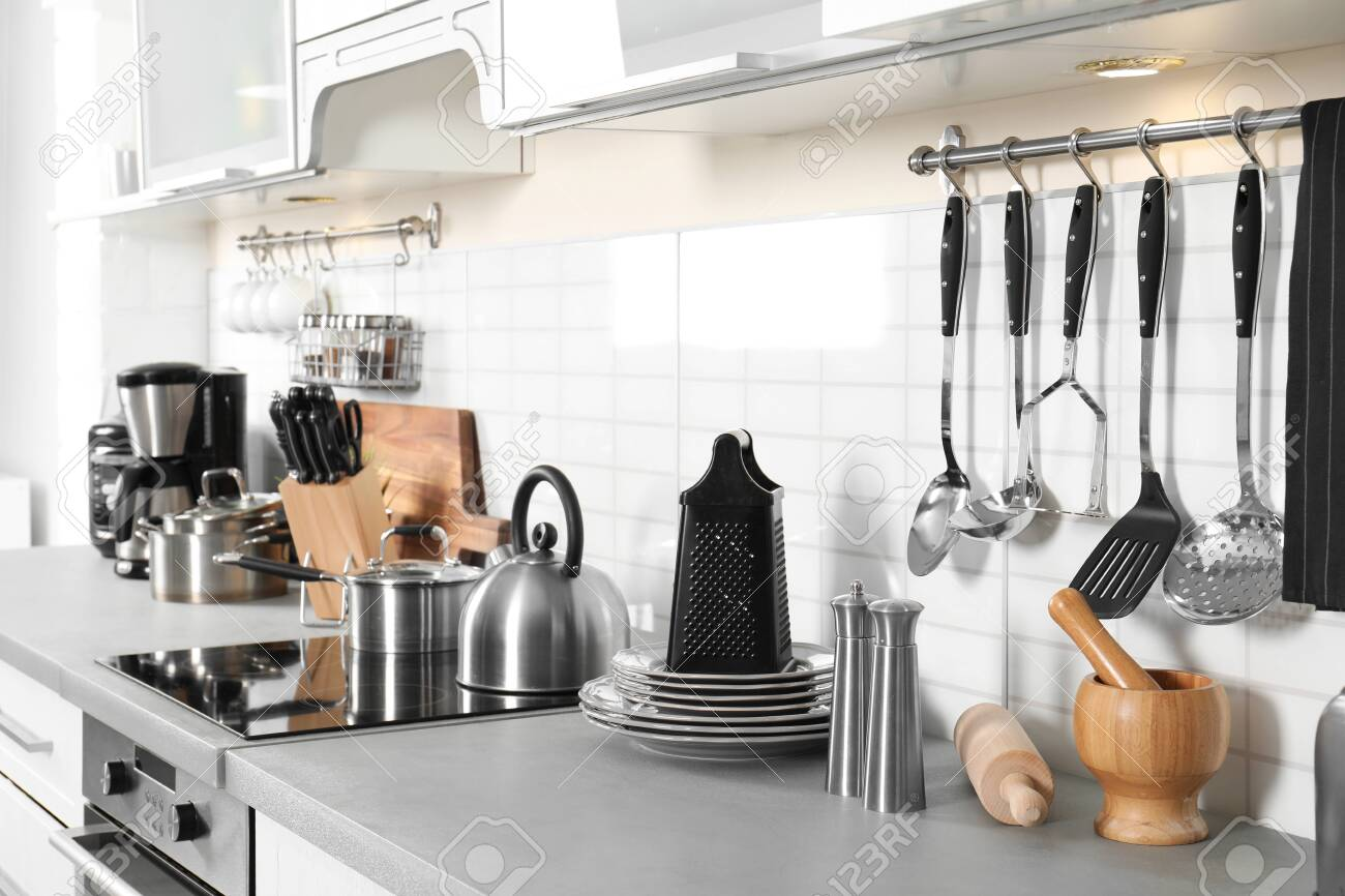 Different Appliances Clean Dishes And Utensils On Kitchen Counter Stock Photo Picture And Royalty Free Image Image 122433879