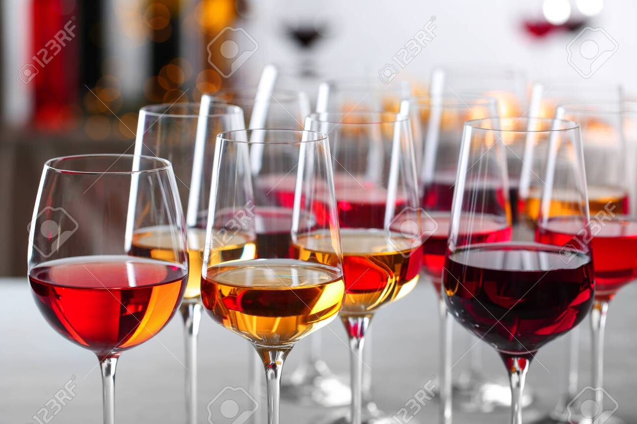 Glasses with different wines on blurred background, closeup - 122529360