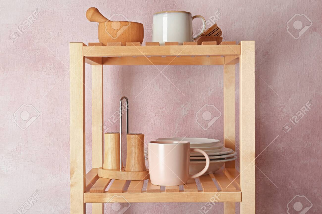 Wooden Shelving Unit With Set Of Kitchenware Near Color Wall Stock Photo Picture And Royalty Free Image Image 124118079