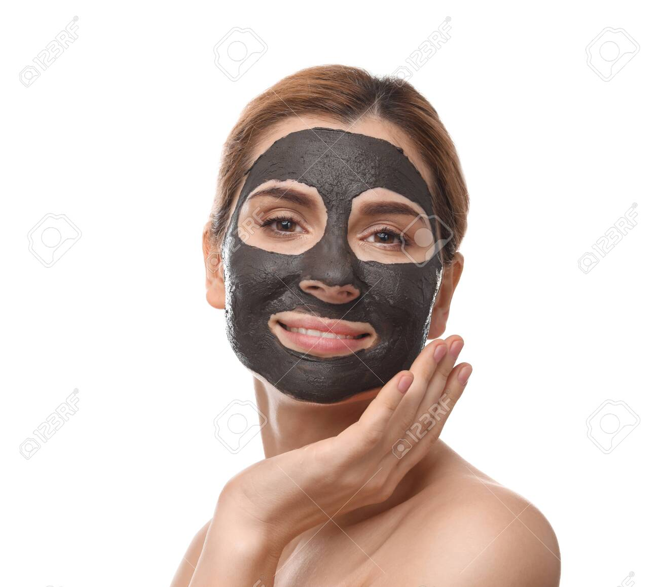 Beautiful woman with black mask on face against white background - 125265842