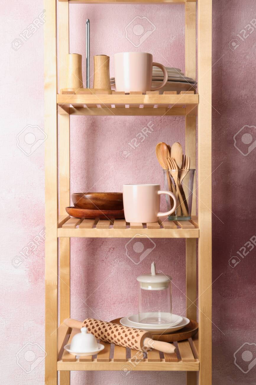 Wooden Shelving Unit With Set Of Kitchenware Near Color Wall Stock Photo Picture And Royalty Free Image Image 124995816