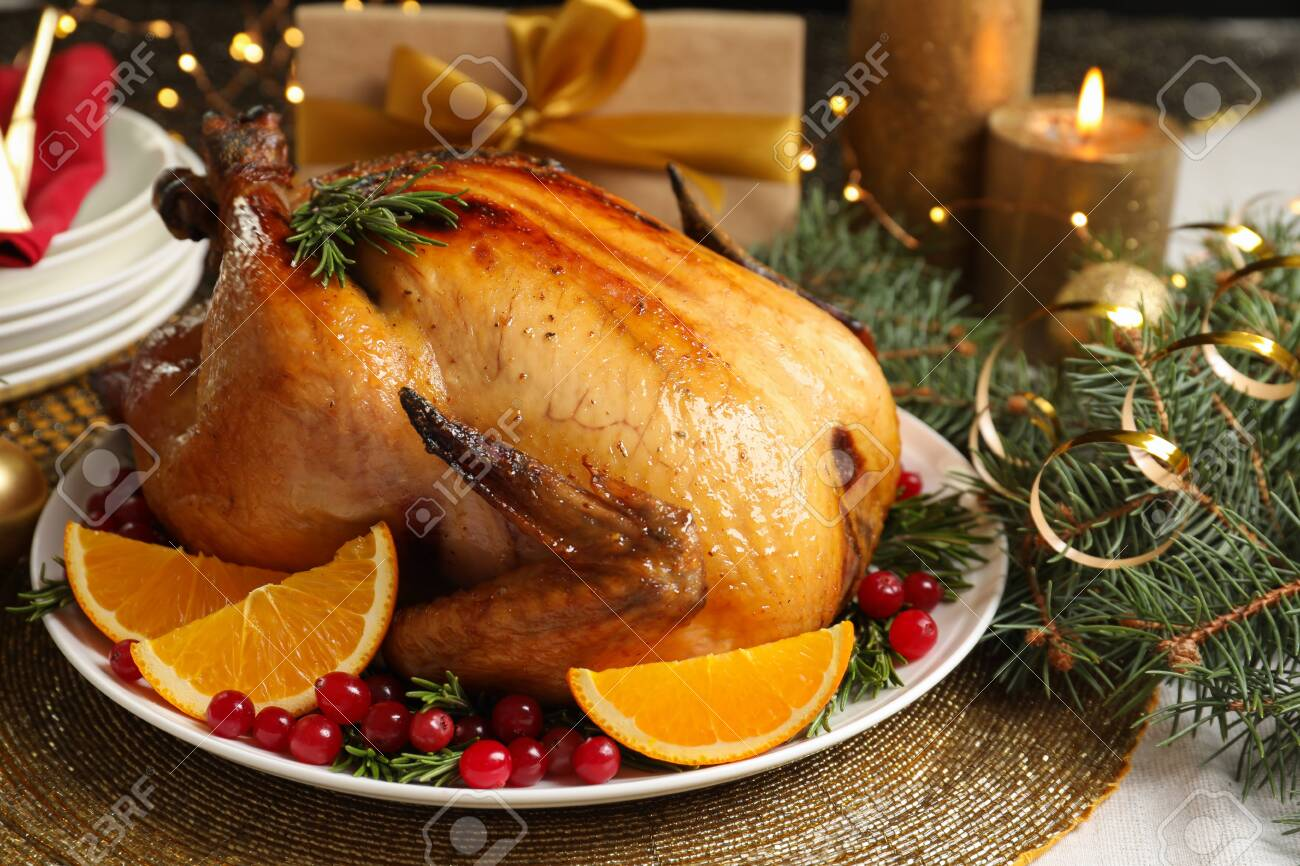 Delicious roasted turkey served for Christmas dinner on table - 124997454