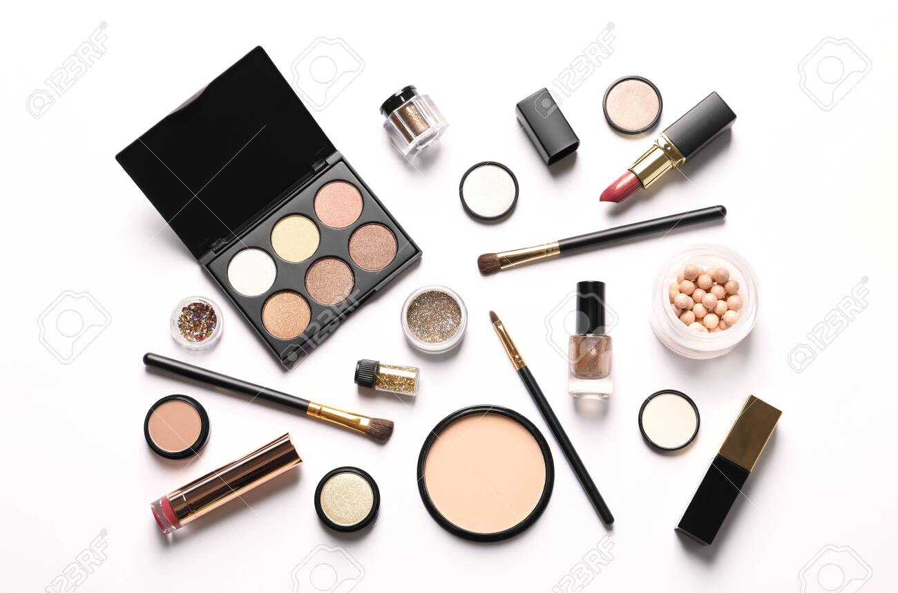 Set of luxury makeup products on white background, top view