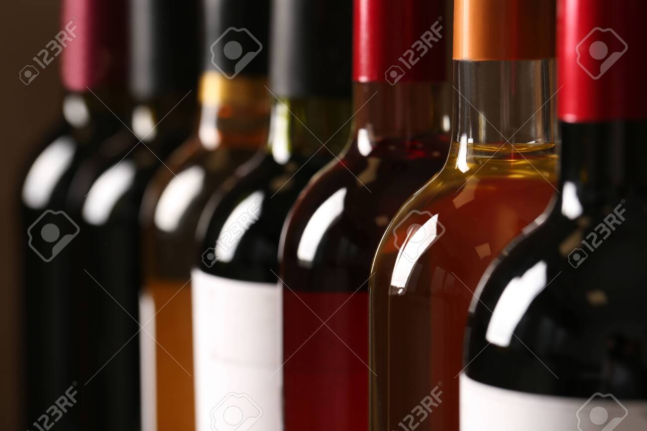 Bottles of different wines, closeup. Expensive collection - 124979562