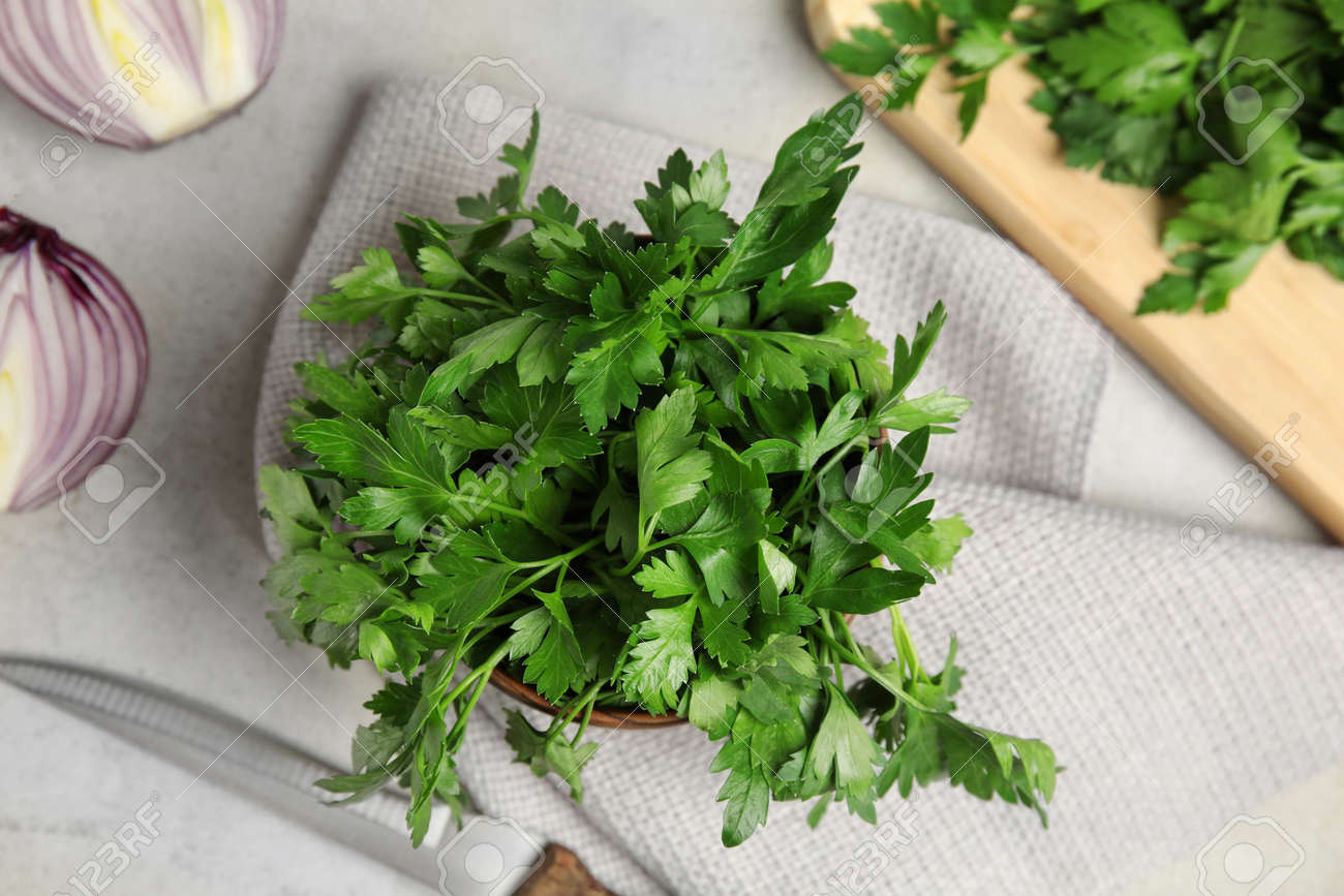 Flat lay composition with fresh green parsley on table - 125051836