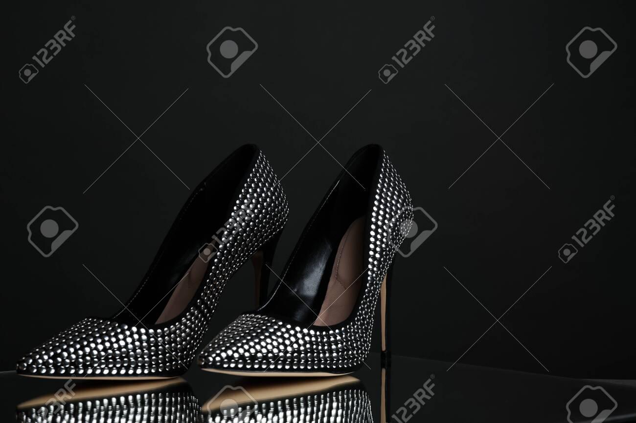 Stylish High Heel Shoes On Dark