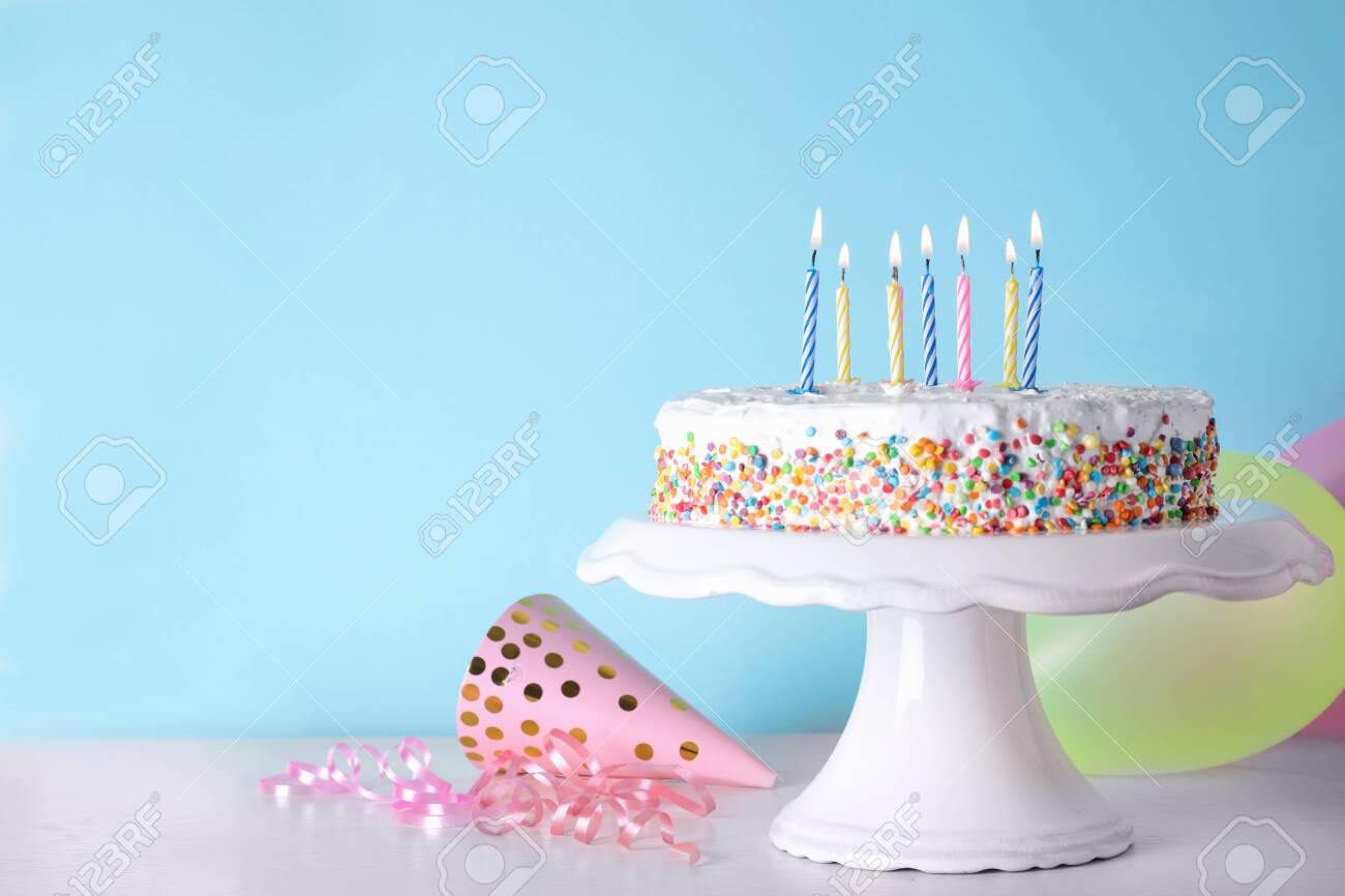 Groovy Birthday Cake With Burning Candles On Table Against Color Funny Birthday Cards Online Overcheapnameinfo