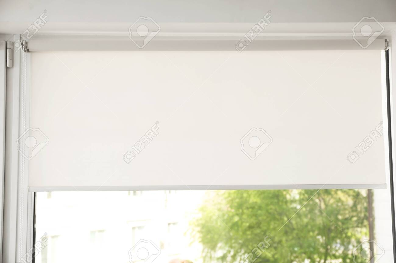 Window with modern roll blinds in room, closeup - 125160207
