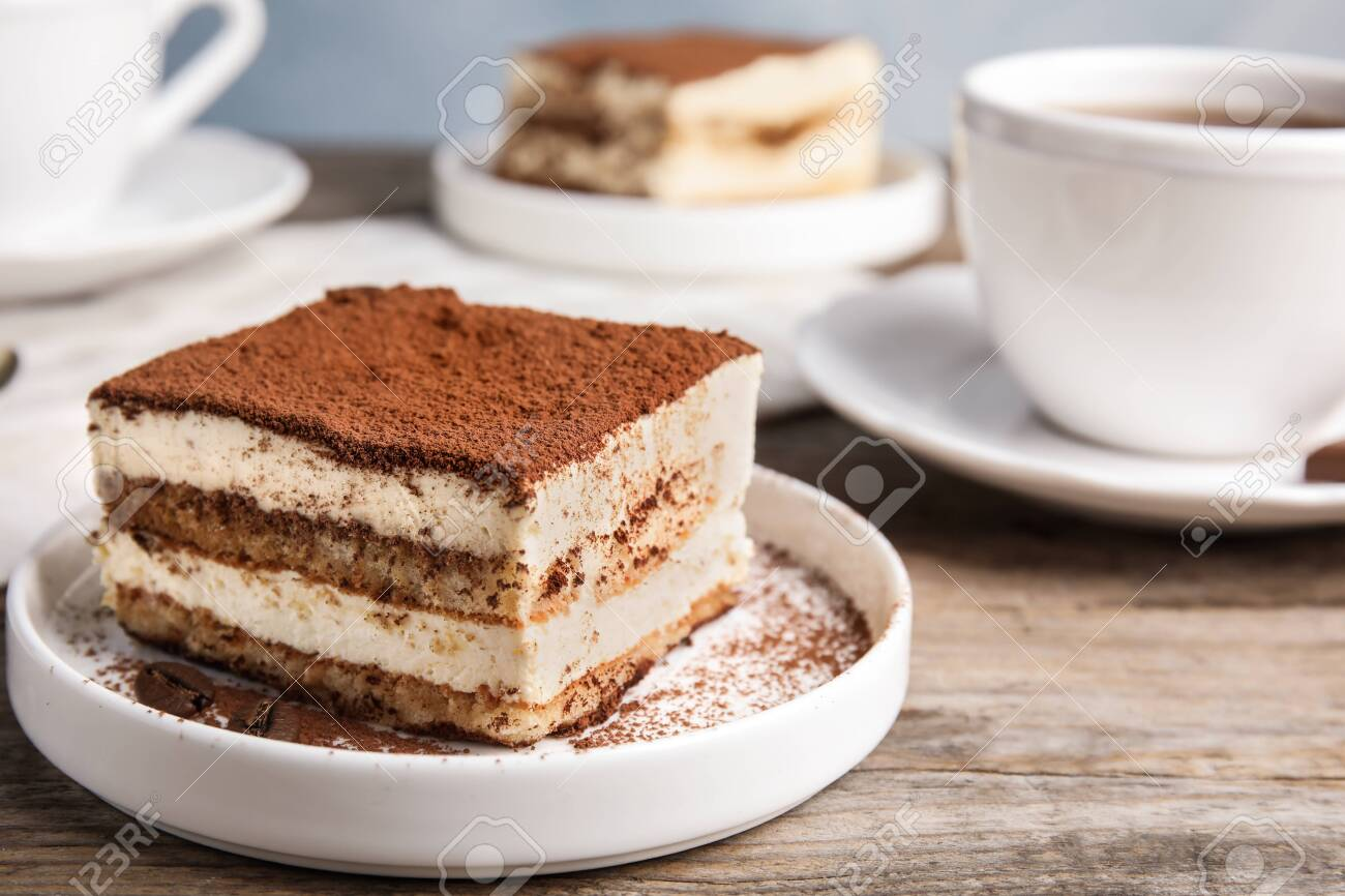Composition with tiramisu cake and tea on table, closeup. Space for text - 125422393