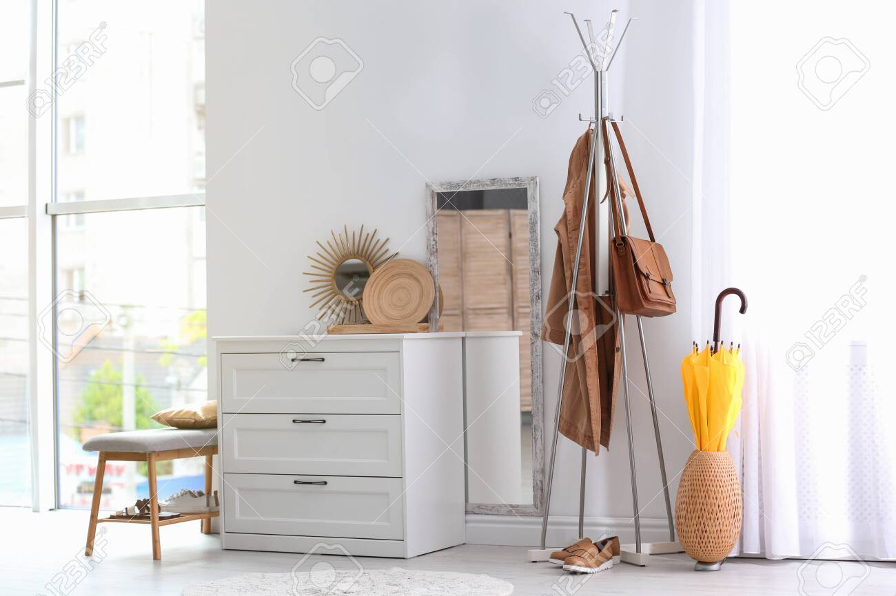 more photos ee5fe 0d65e Modern hallway interior with chest of drawers and clothes on..