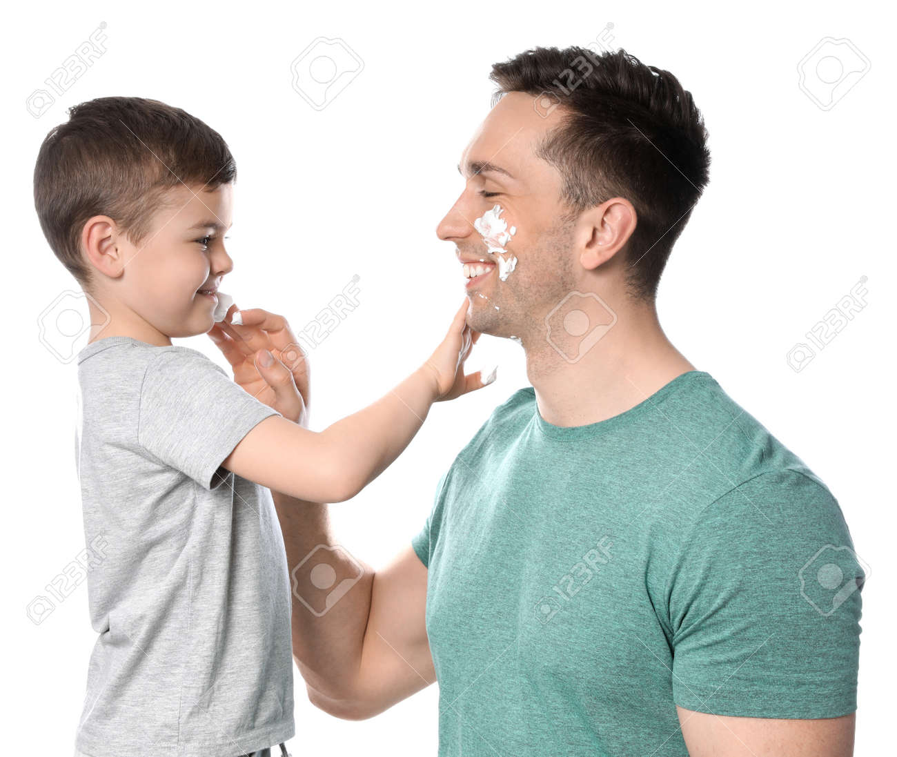Dad and his little son applying shaving foam against white background - 126211844