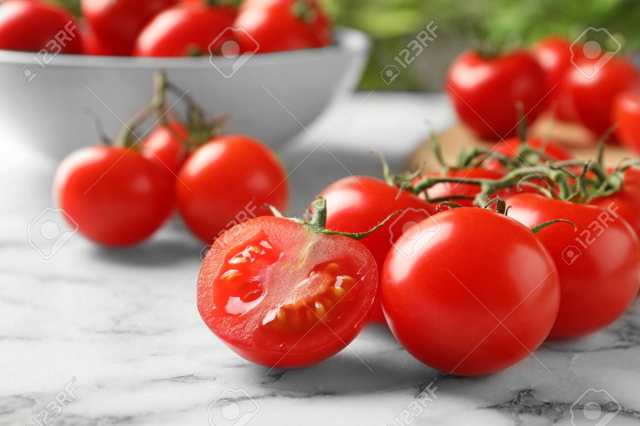 Branch of fresh cherry tomatoes on marble background - 126607175