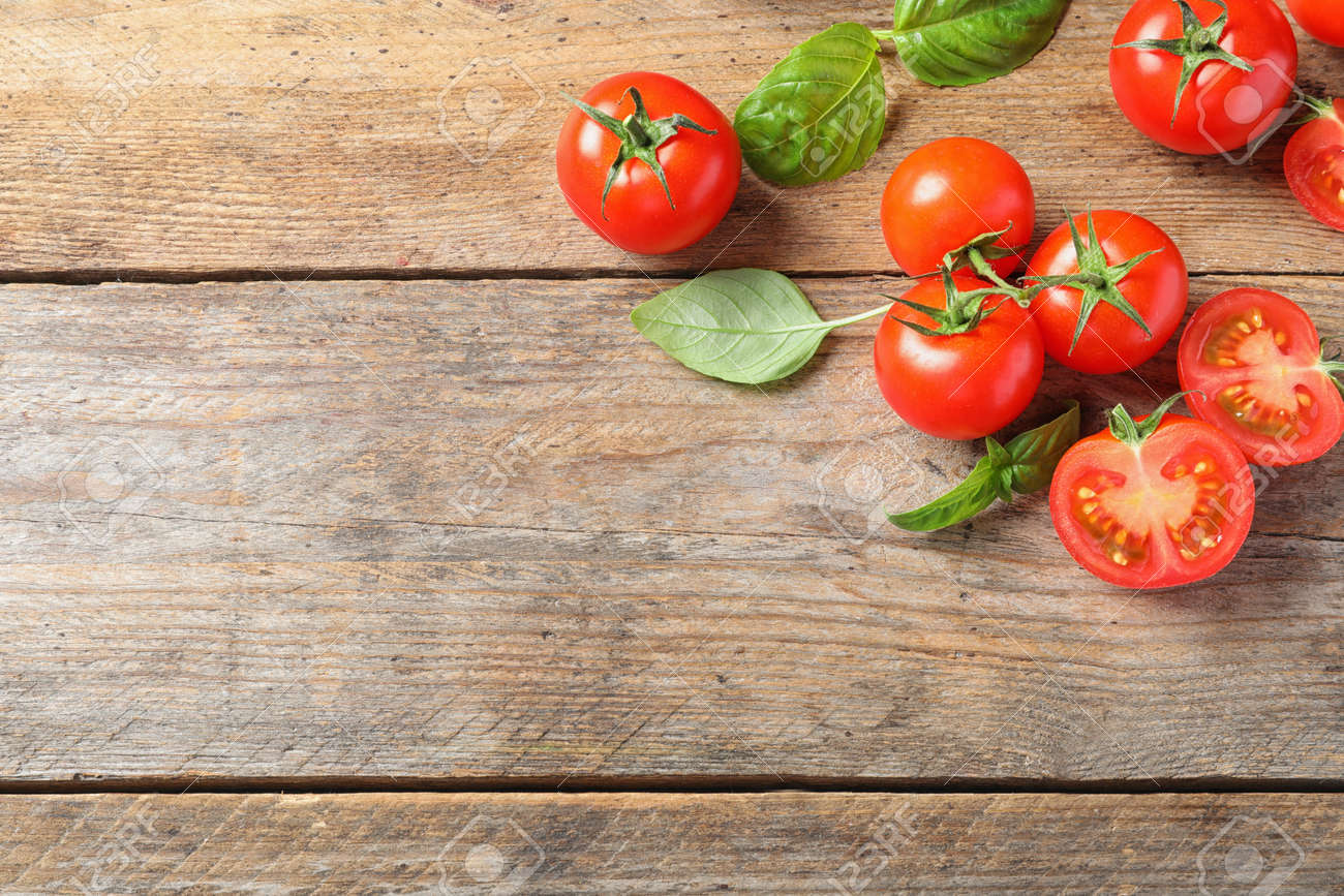 Fresh cherry tomatoes on wooden background, flat lay. Space for text - 126675187