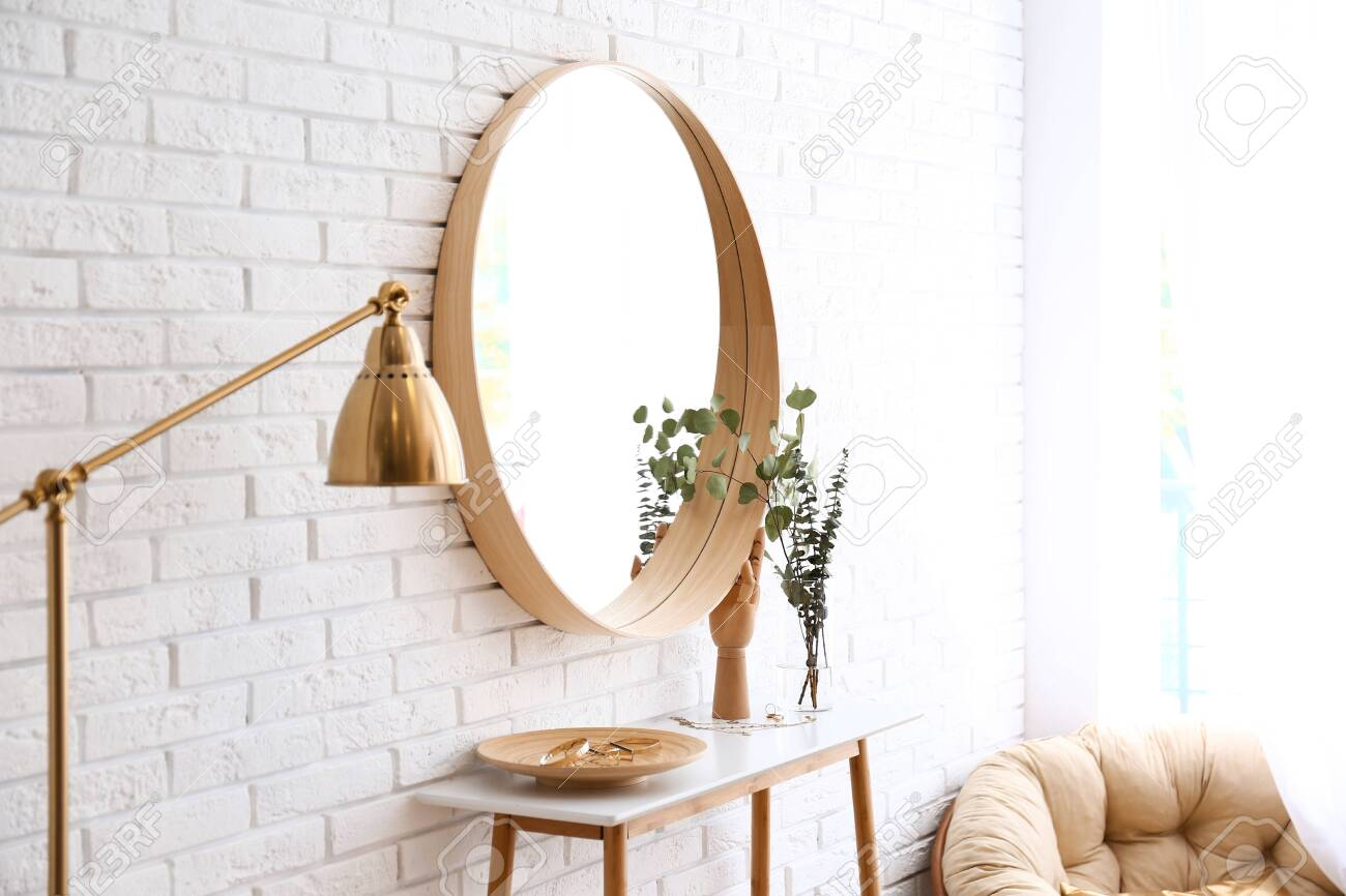 Big Round Mirror Table With Jewelry And Decor Near Brick Wall Stock Photo Picture And Royalty Free Image Image 126681703