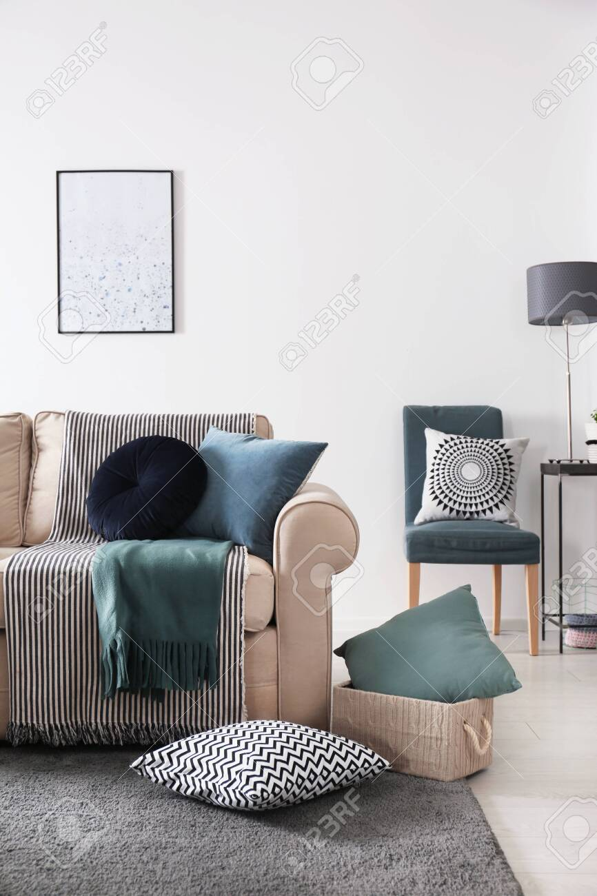 Living room interior with comfortable sofa and pillows - 126979543