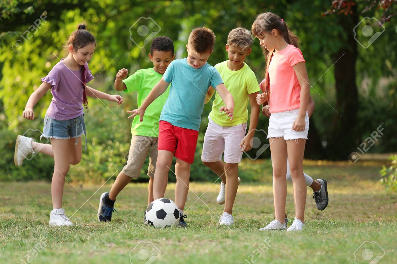Cute little children playing with soccer ball in park - 127124339