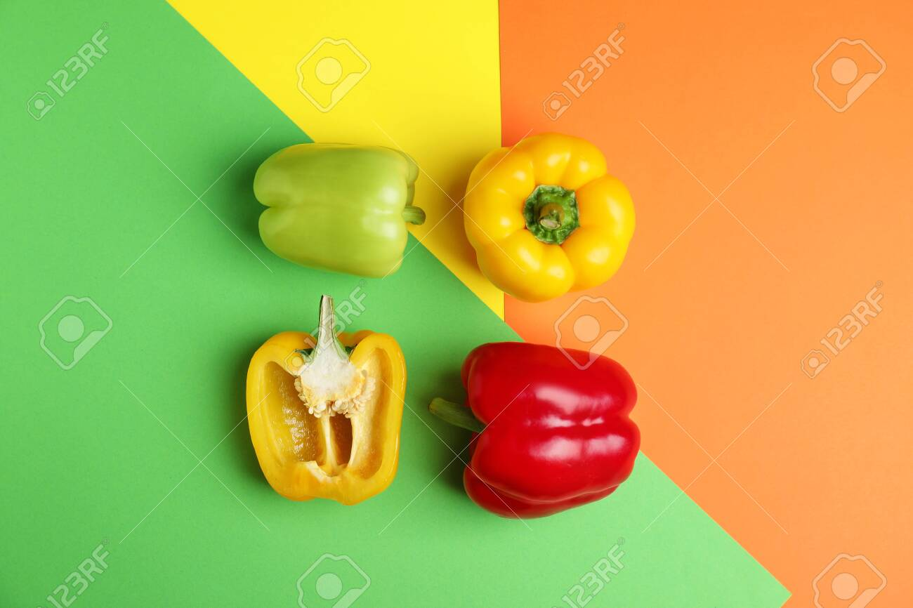 Flat lay composition with ripe bell peppers on color background - 127452718