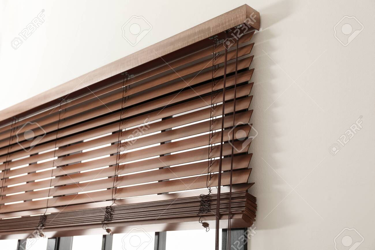 Modern Window With Stylish Wooden Blinds Indoors Stock Photo Picture And Royalty Free Image Image 127755570