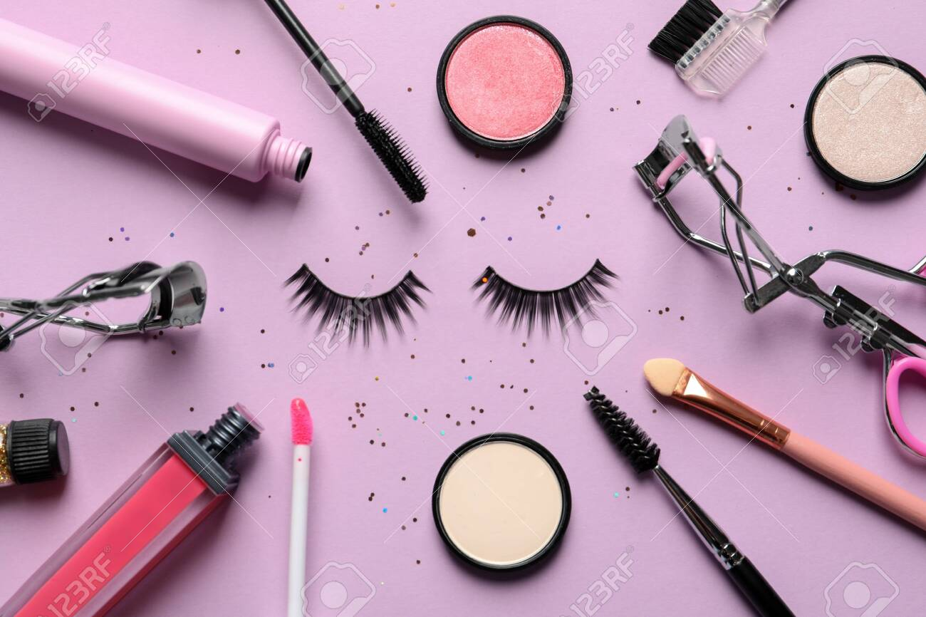 Flat lay composition with false eyelashes and other makeup products..