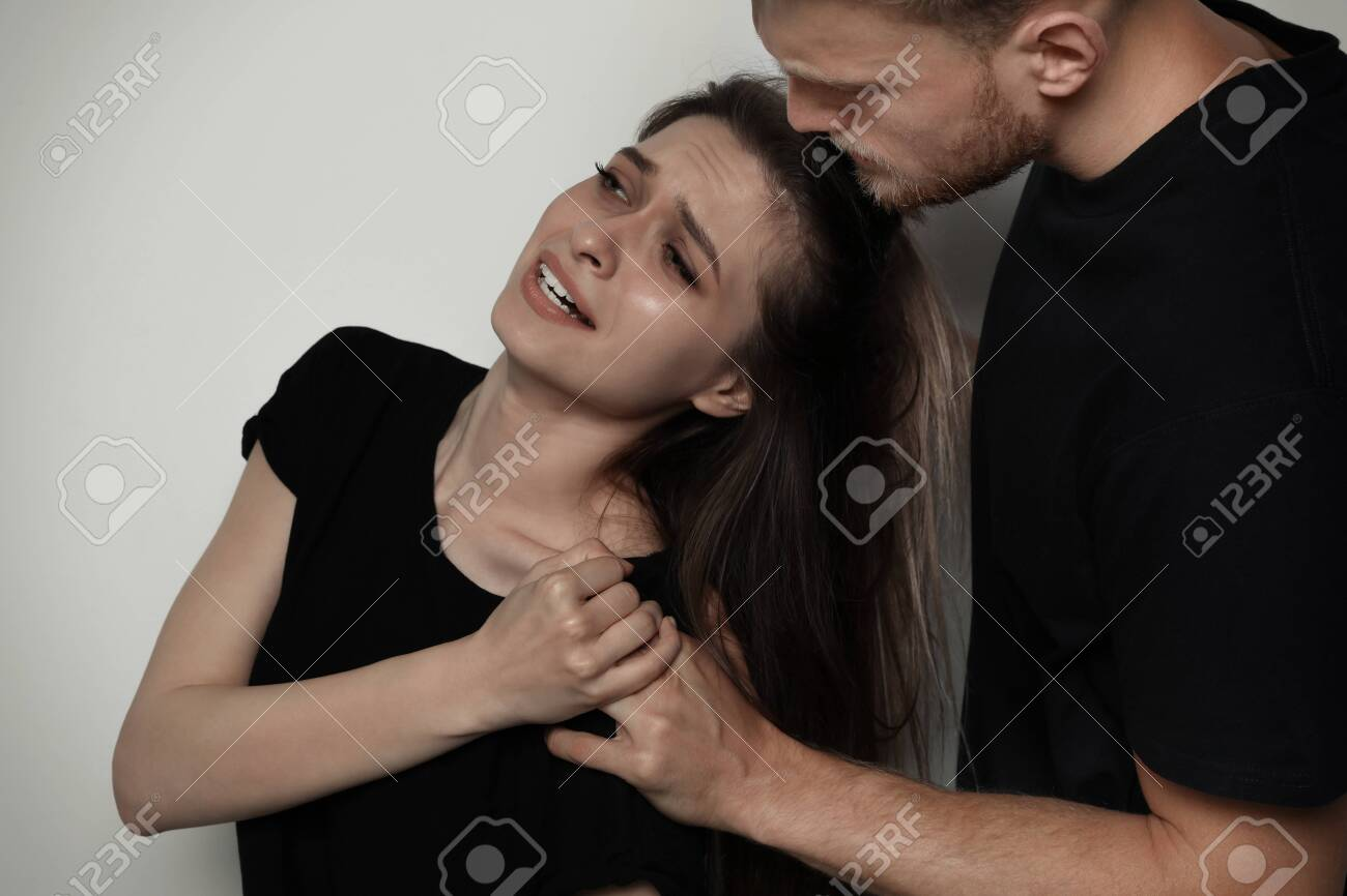 Man fighting with woman on light background. Stop assault - 128518433