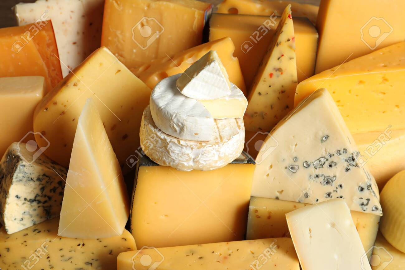 Different types of delicious cheese as background, closeup - 127984789