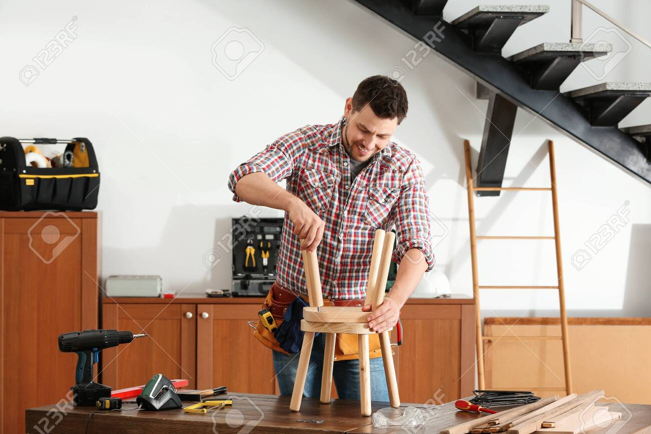 Astonishing Handsome Working Man Repairing Wooden Stool Indoors Ocoug Best Dining Table And Chair Ideas Images Ocougorg