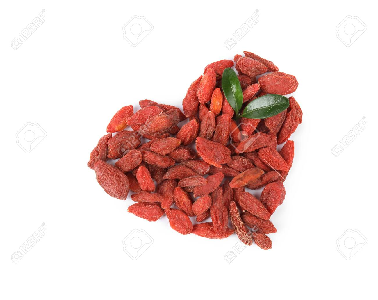 Heart Shaped Pile Of Dried Goji Berries With Leaves On White