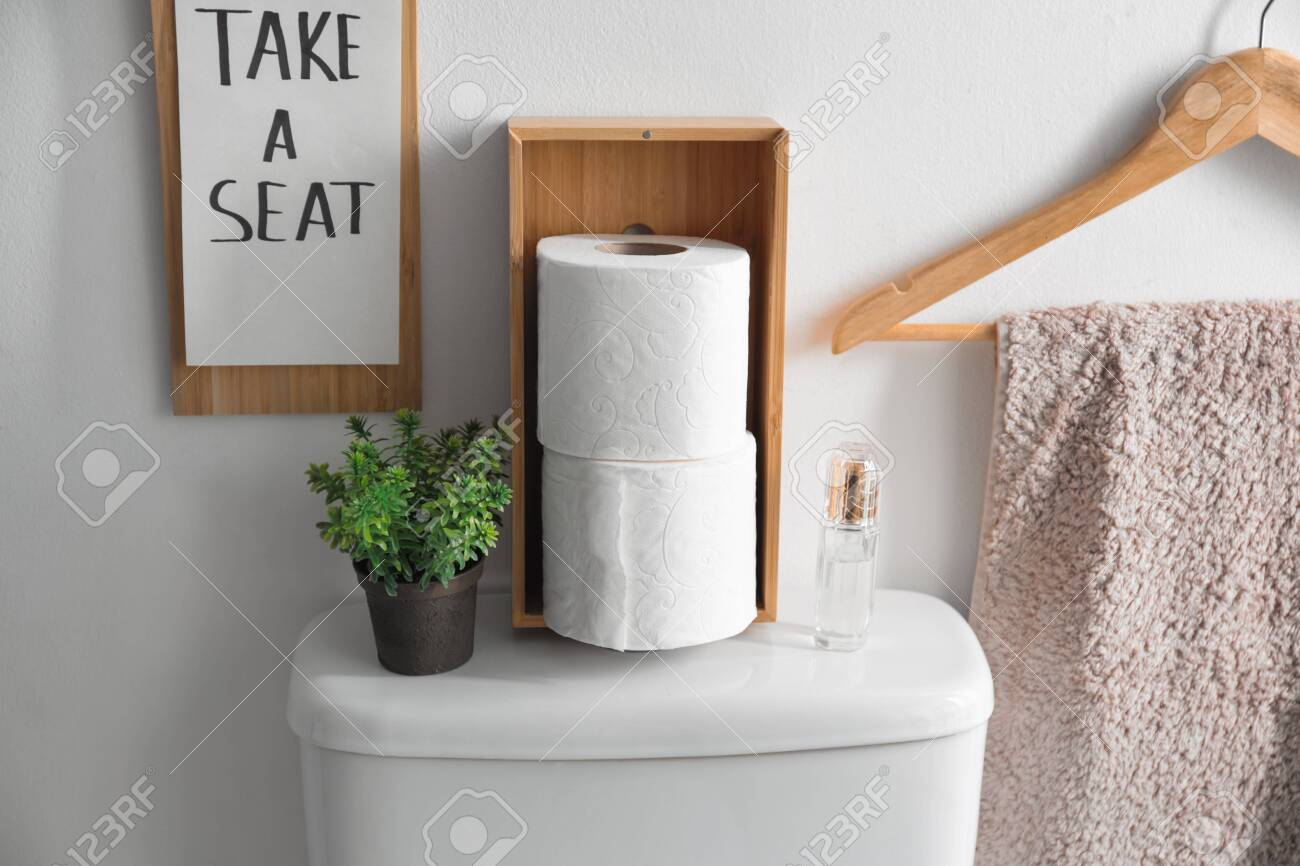 Decor Elements Necessities And Toilet Bowl Near White Wall