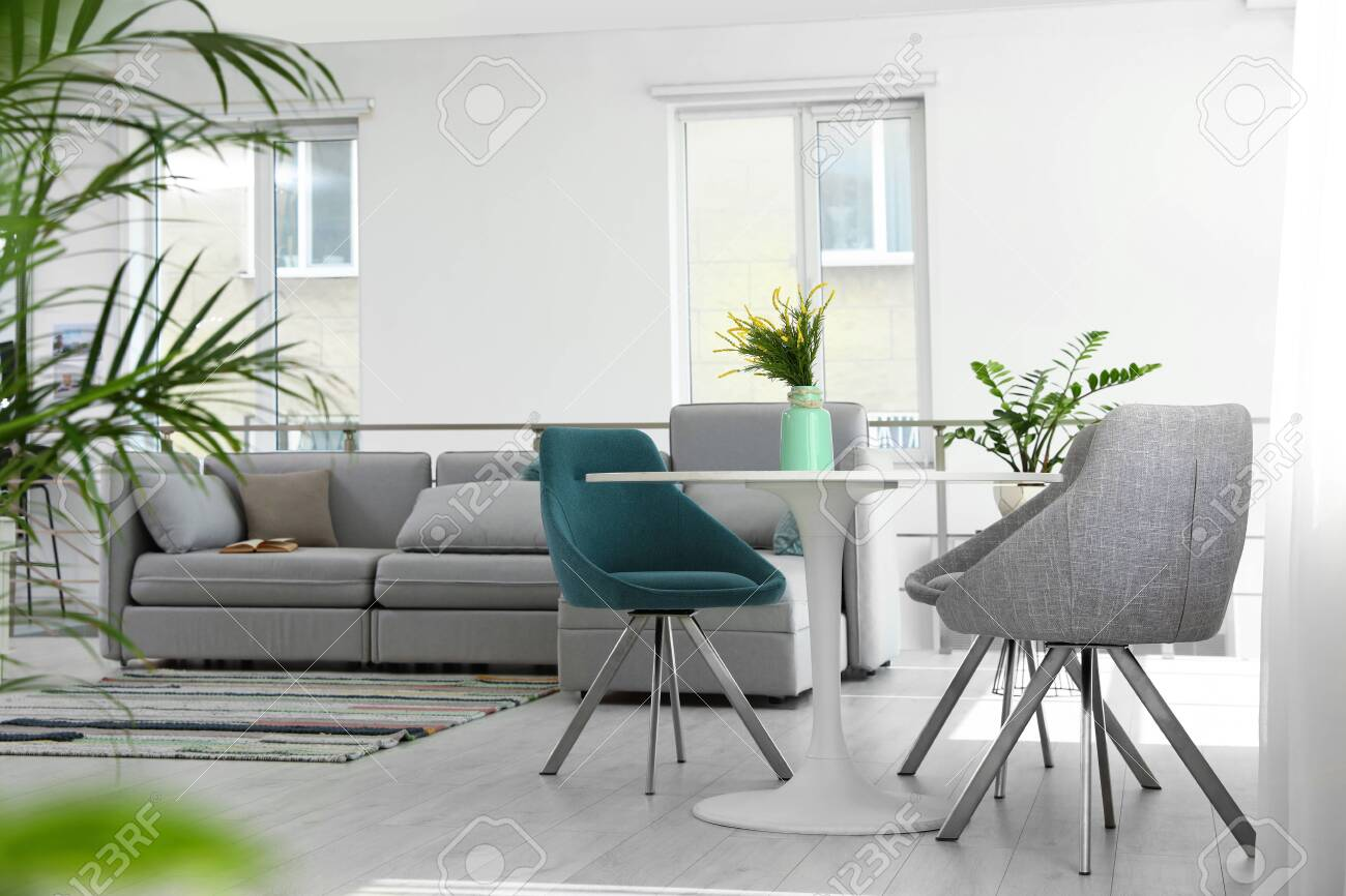 Modern Living Room Interior With Round Table And Stylish Chairs Stock Photo Picture And Royalty Free Image Image 128760423