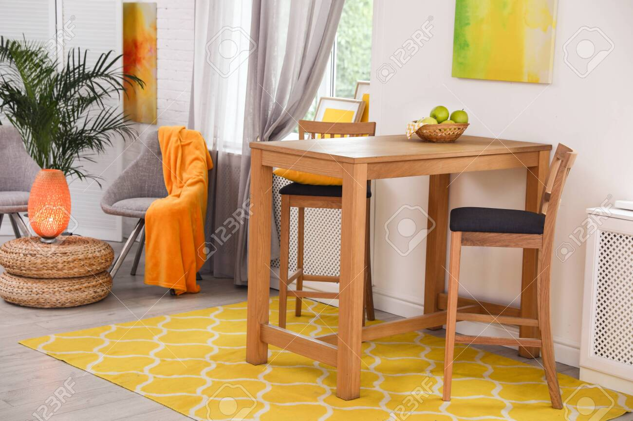 Modern dining room interior with wooden table and chairs - 128820474