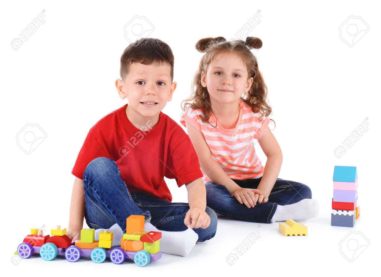Cute little children playing with toys on white background - 129115793