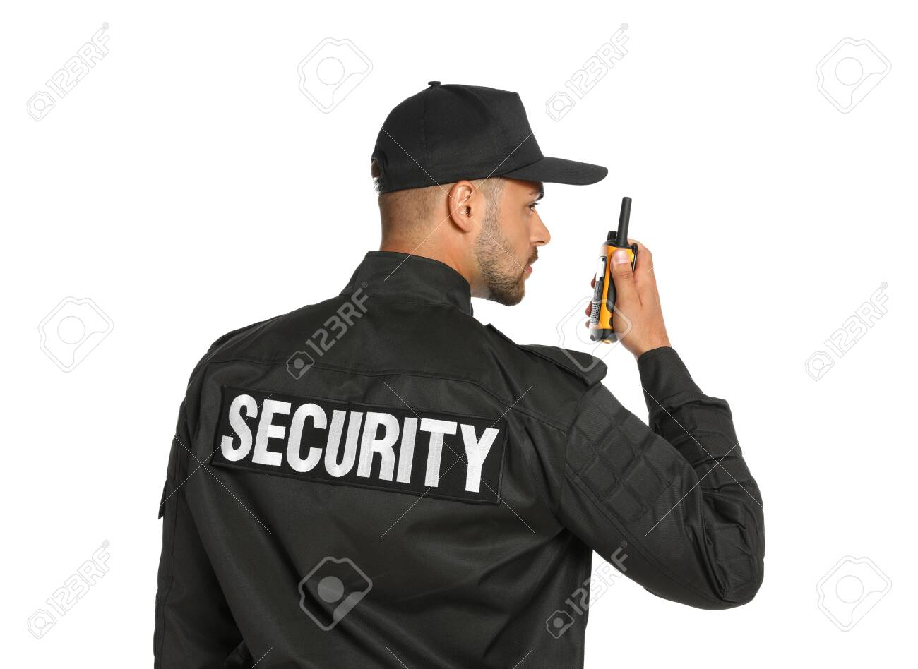 Male security guard in uniform using portable radio transmitter on white background - 129030450