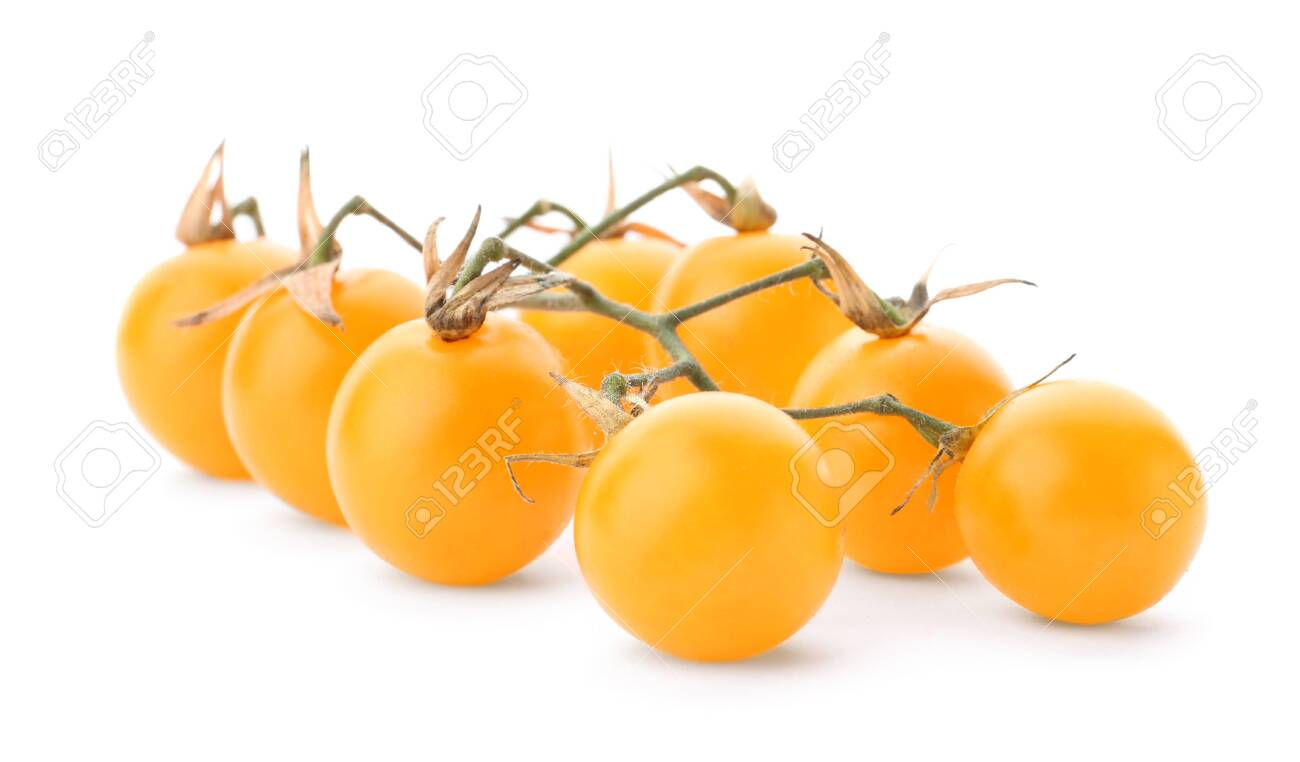Branch of ripe yellow cherry tomatoes on white background - 128876659