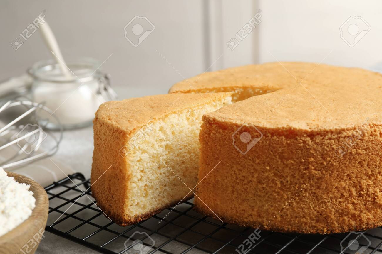 Delicious fresh homemade cake on grey table - 128968544
