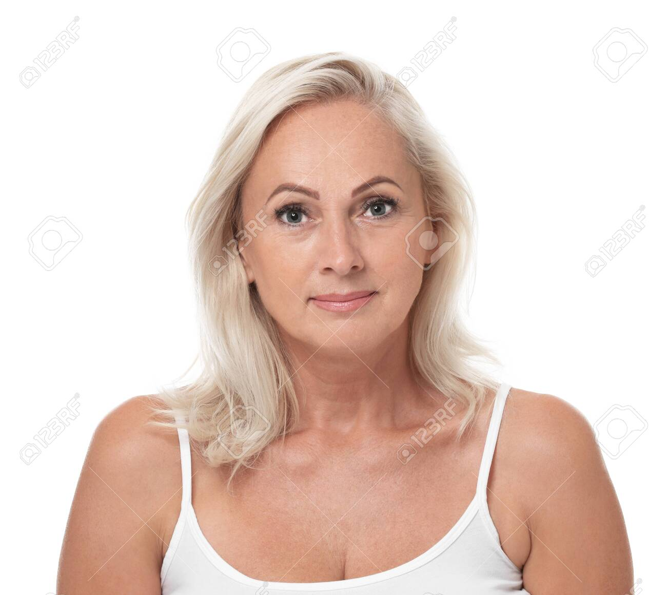 Portrait of beautiful mature woman with perfect skin on white background - 129470376