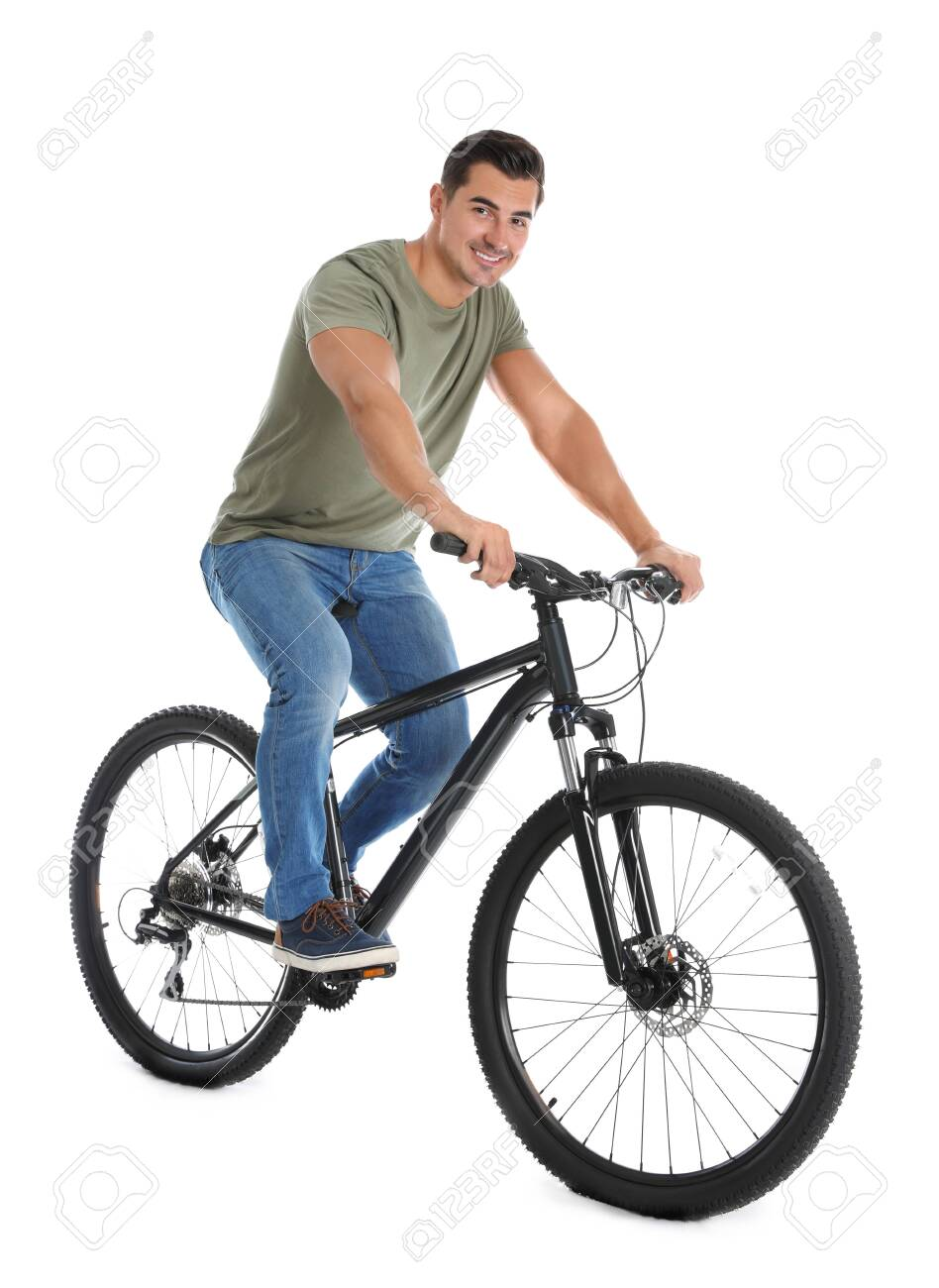 Handsome young man with modern bicycle on white background - 129915076