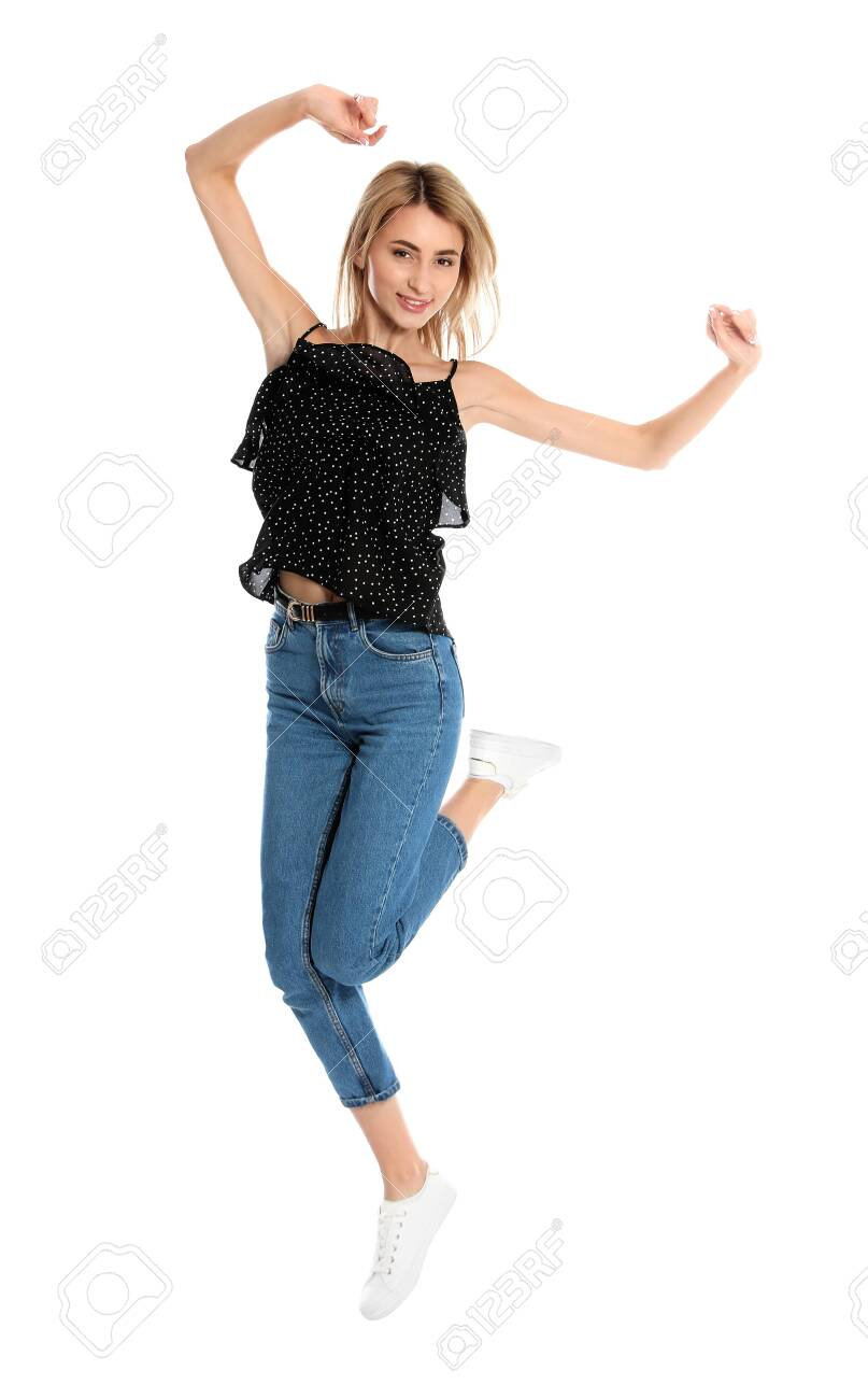 Beautiful young woman jumping on white background - 129918865