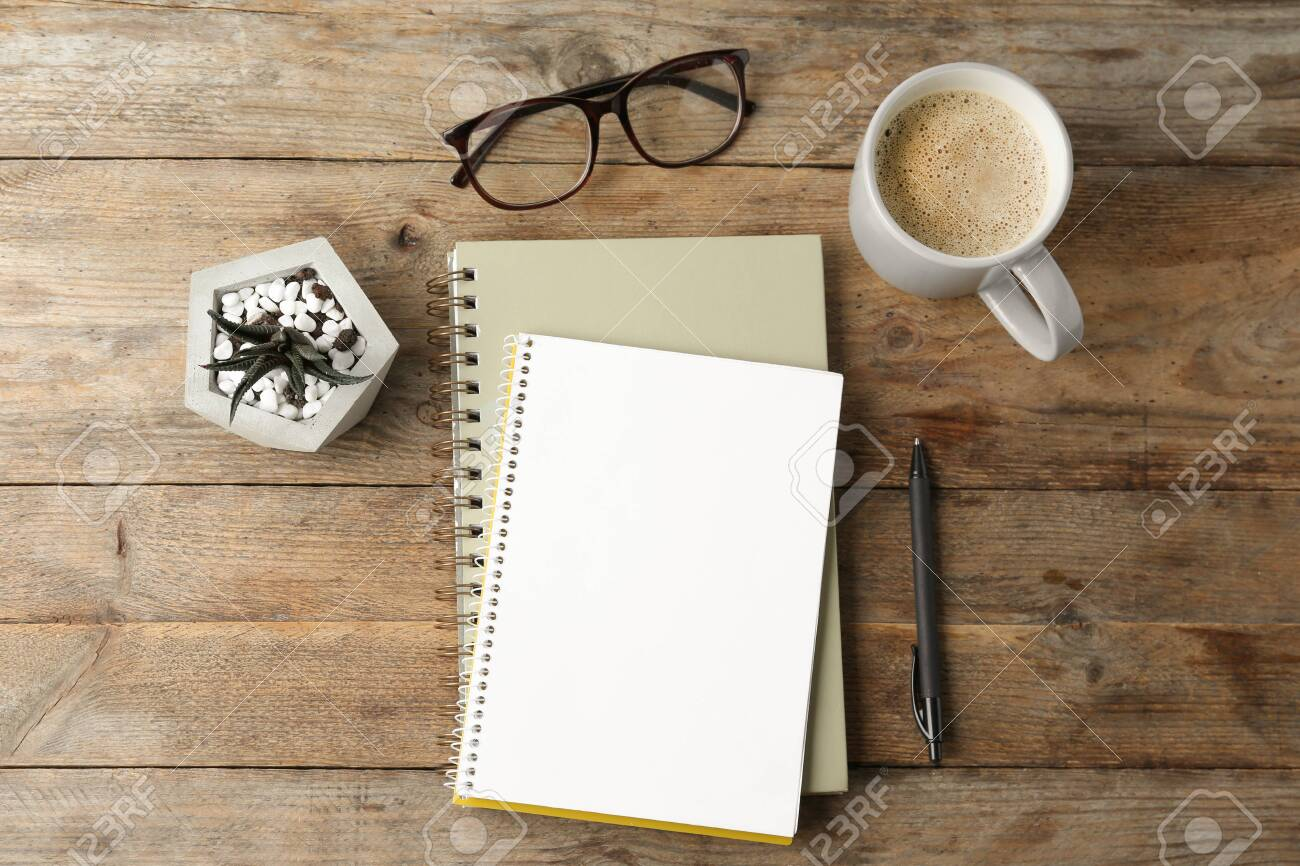 Flat lay composition with office stationery and cup of coffee on wooden table. Space for design - 130356630